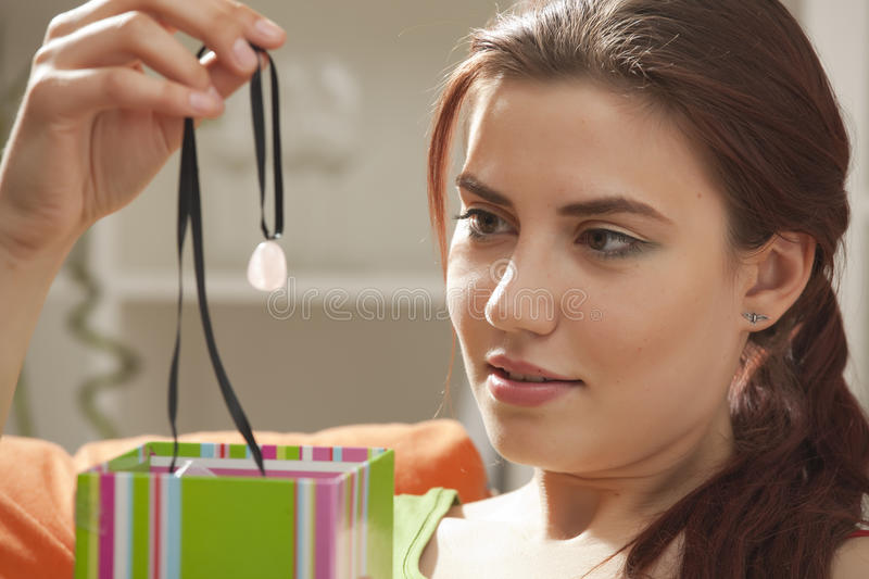 Woman holding a gift royalty free stock photo