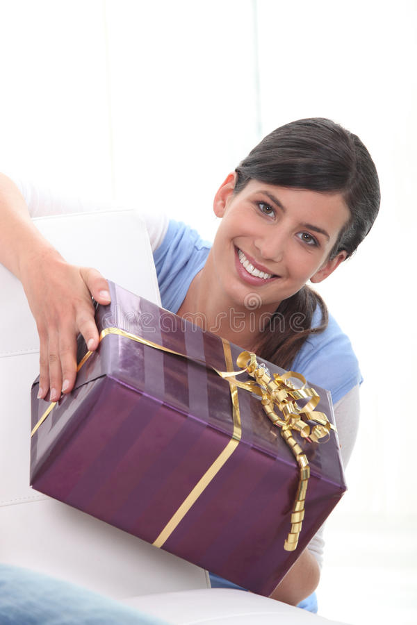 Woman Holding Gift Stock Image