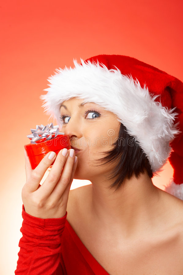 Woman holding gift stock photography