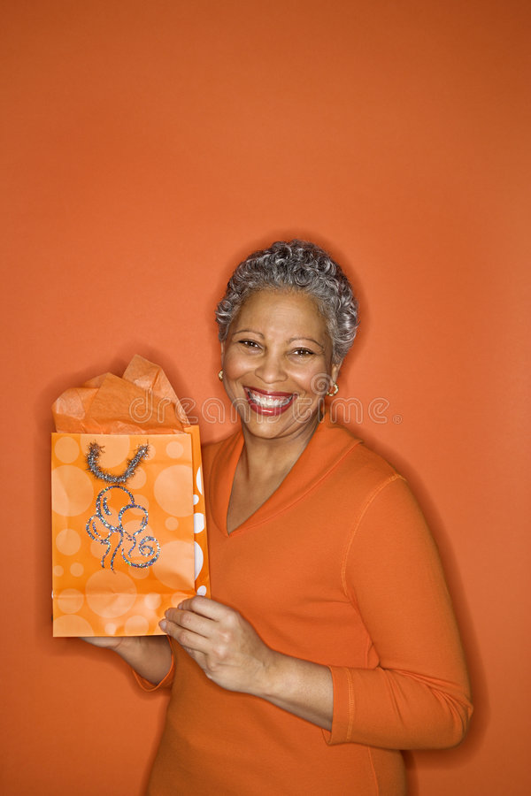 Woman holding gift bag. royalty free stock image