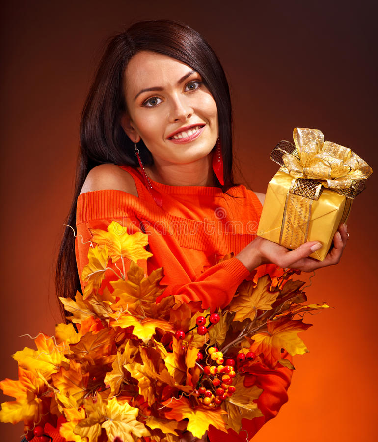 Download Woman holding gift box. stock image. Image of long, leaves - 26671723