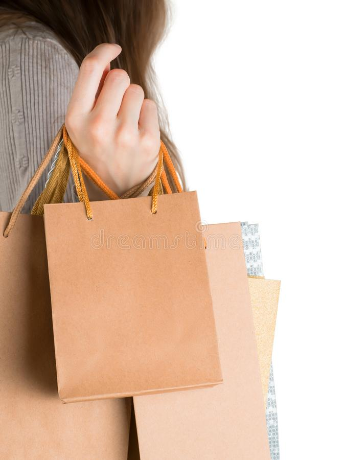 Woman holding gift or shopping bags isolated on white royalty free stock image