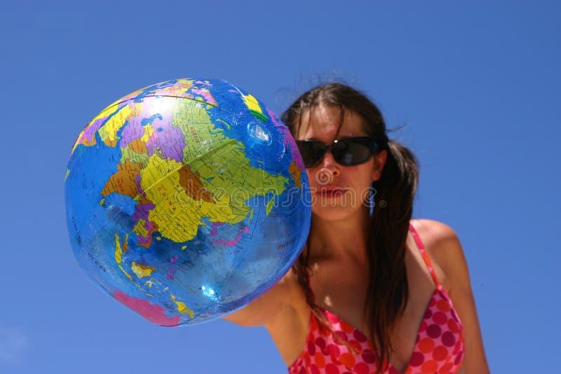 Woman holding a globe royalty free stock photos