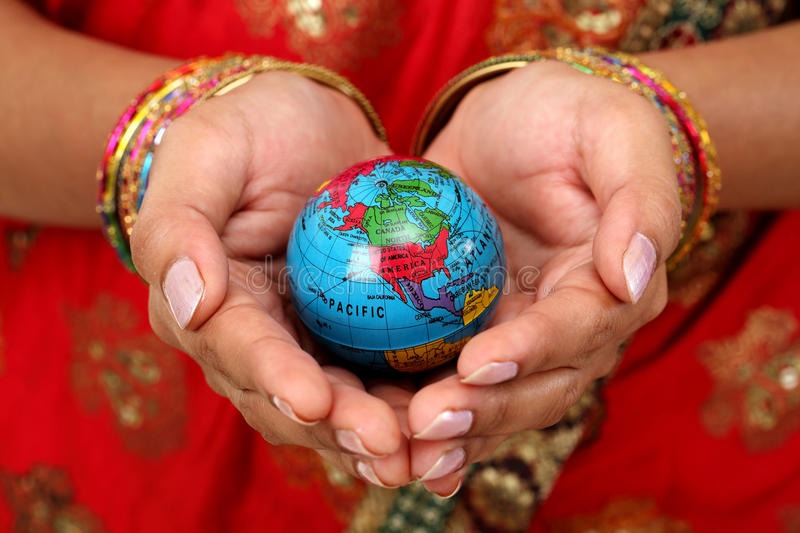 Woman holding globe on her hands stock images