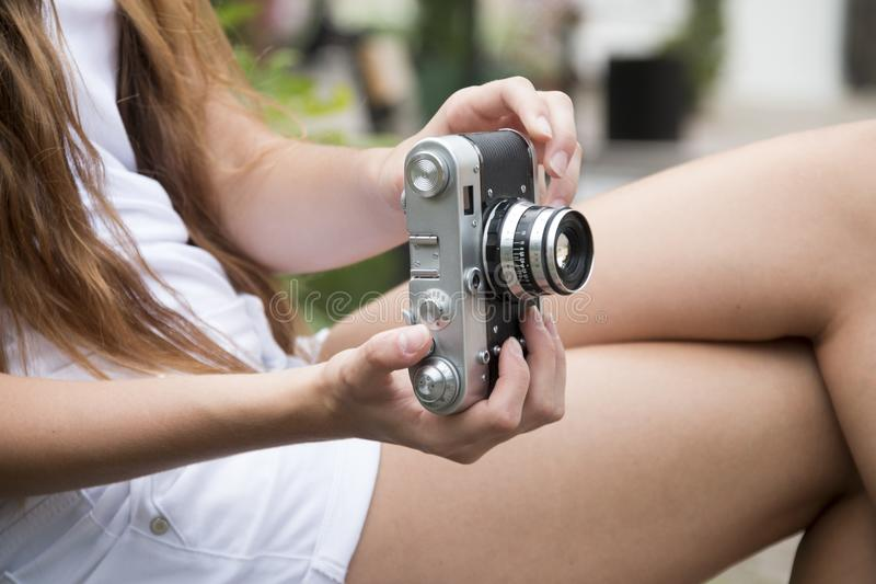 Woman Holding a Gray and Black Adjustable Lens Camera royalty free stock image