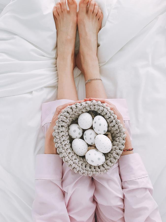 Woman Holding Gray Crochet Bowl With Seven Painted Eggs royalty free stock image