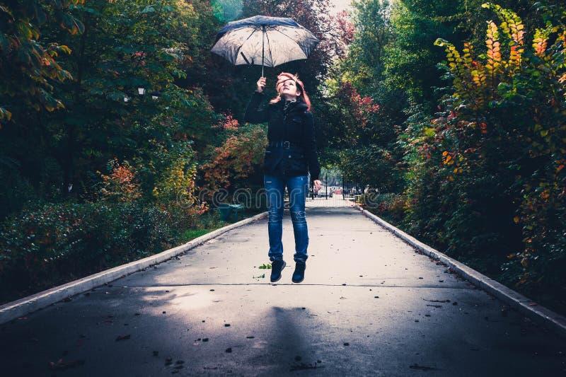 Woman Holding Gray Umbrella royalty free stock photography