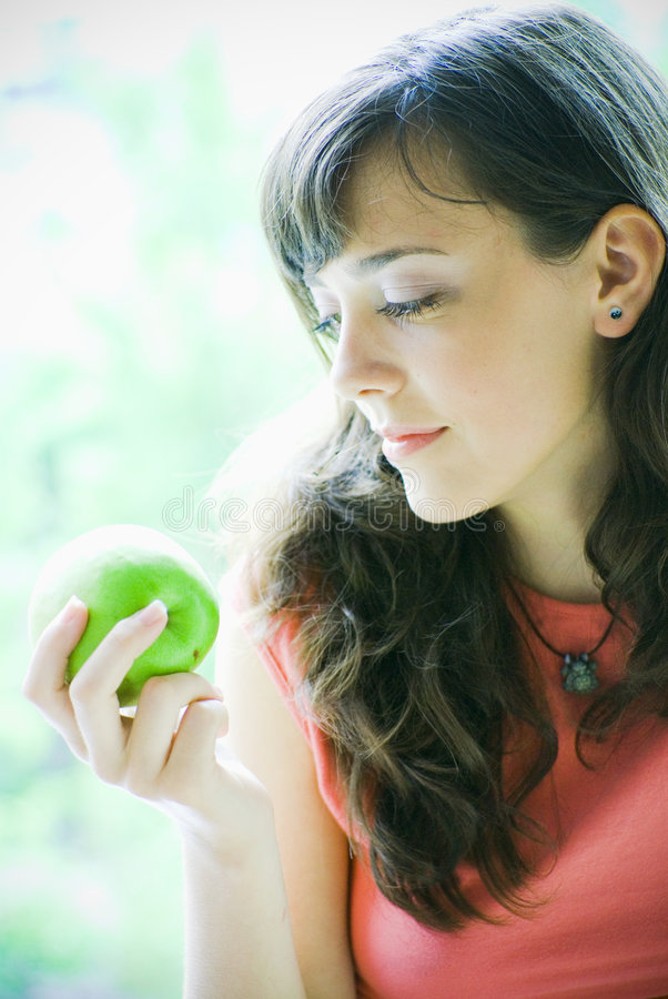 Download Woman Holding A Green Apple Stock Image - Image: 2715821