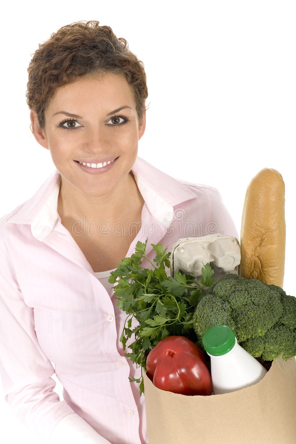 Woman holding grocery bag stock images