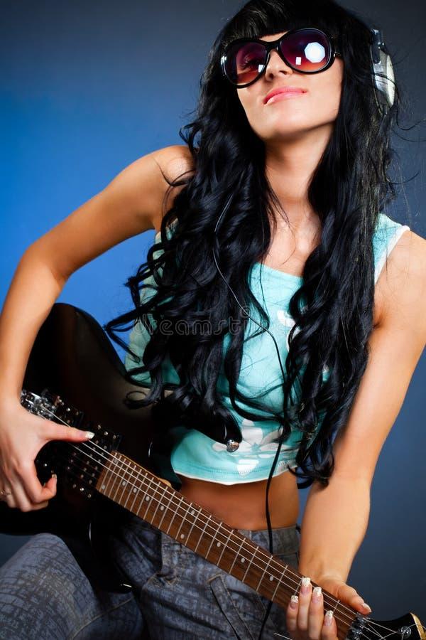 Woman holding guitar stock photos
