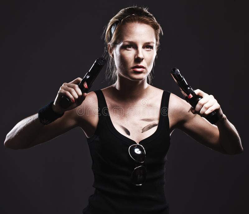 Woman holding gun royalty free stock photography