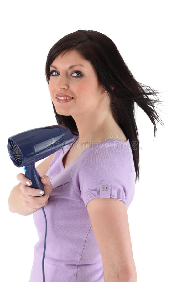 Woman holding a hairdryer stock image