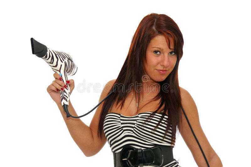 Woman holding hairdryer stock photo