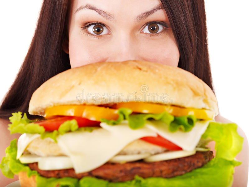 Woman holding hamburger. Isolated royalty free stock image