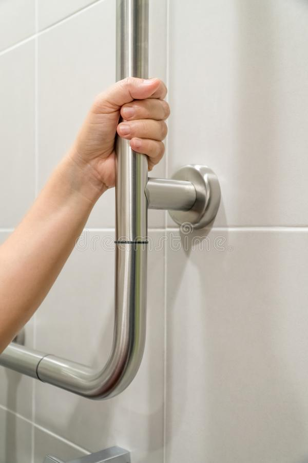 Woman Holding On Handrail In Toilet. Stock Image - Image of person ...