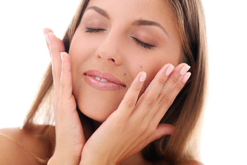 Woman holding hands near her face stock images