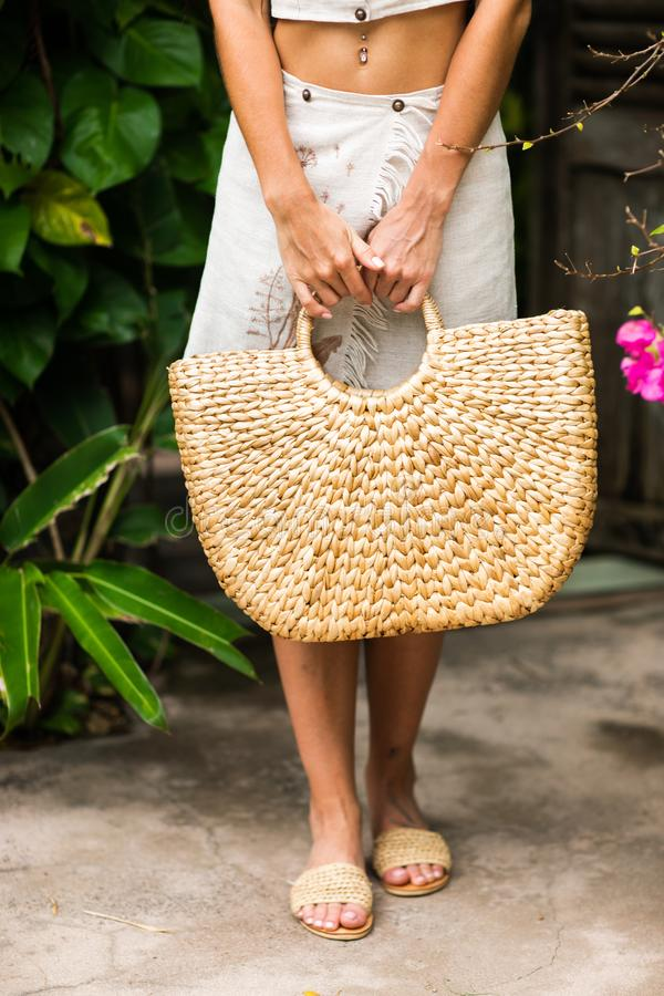 Woman hands with straw bag. stock image