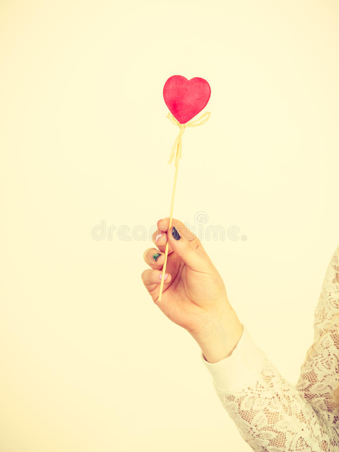 Download Woman Holding Heart Shaped Hand Stick Stock Image - Image: 83711901
