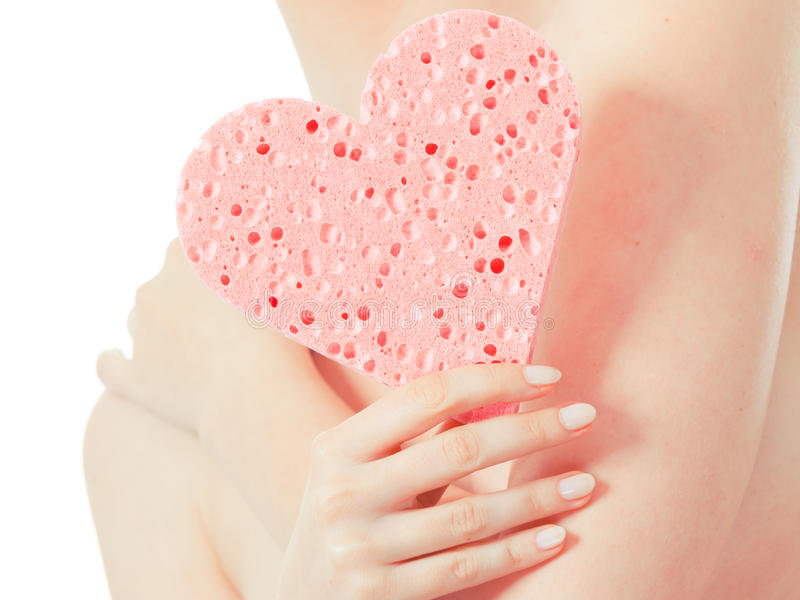 Woman holding heart sponge closeup stock image