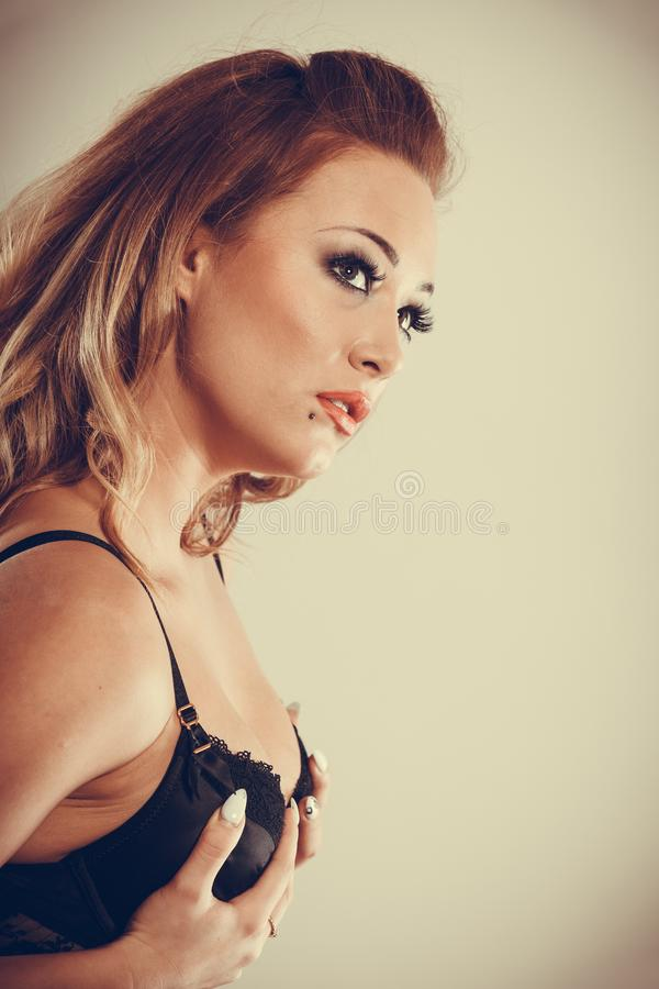 Woman holding her breast. stock image