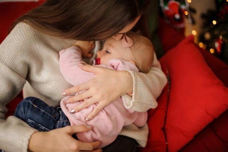 Woman holding her cute little daughter on hands royalty free stock images