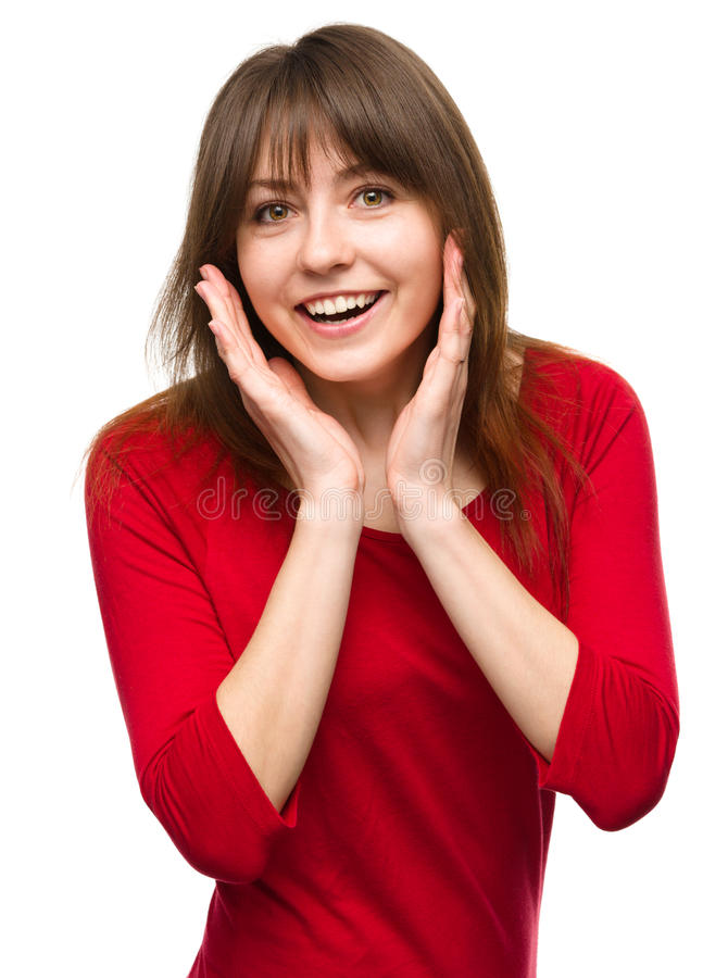 Woman is holding her face in astonishment. Young woman is holding her face in astonishment, isolated over white royalty free stock photography