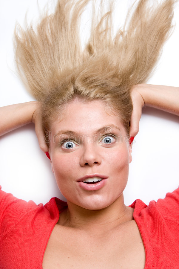 Woman Holding Her Head Looking Up Surprised Royalty Free Stock Image