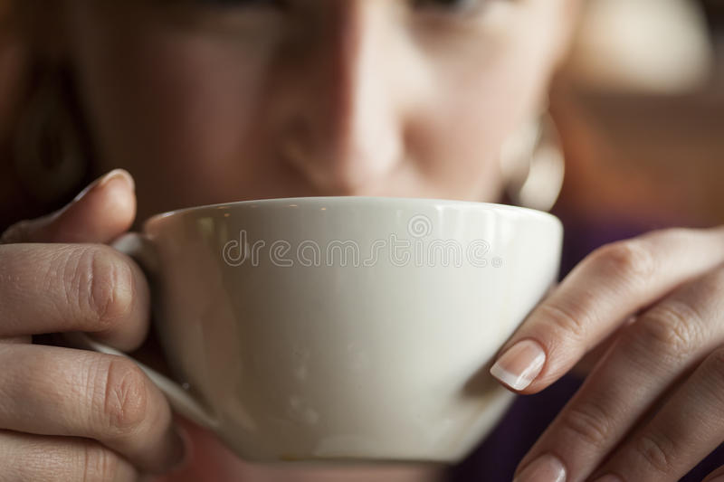 Woman Holding Her Morning Cup of Coffee royalty free stock photography