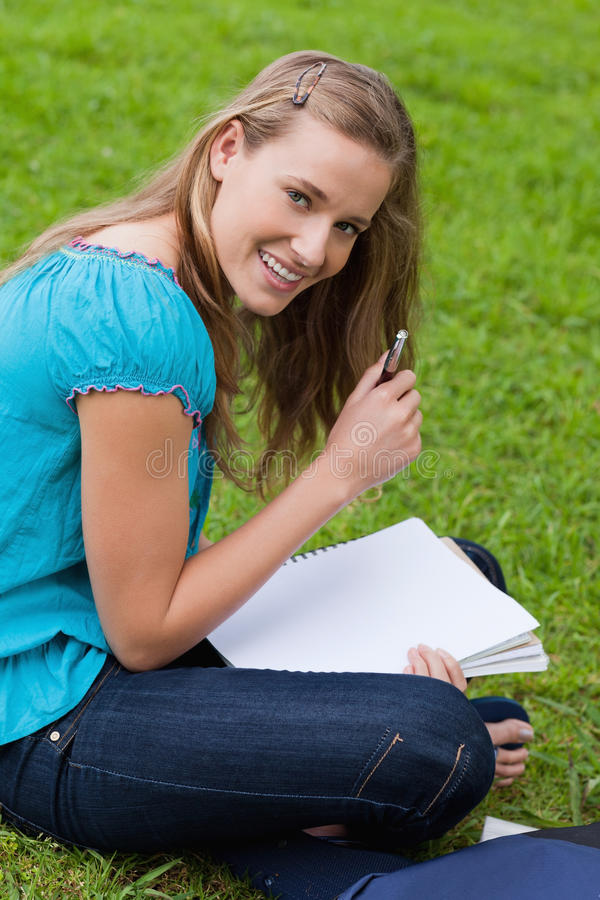 Download Woman Holding Her Pen While Looking At The Camera Stock Image - Image of holding, notebook: 25331467
