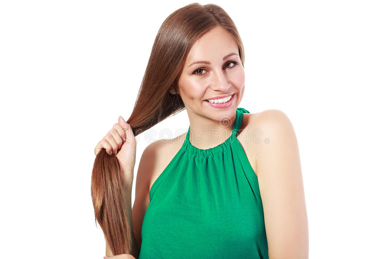 Woman holding her strong hair. Young attractive smiling woman holding her strong hair and smiling shampoo concept isolated on white stock photos