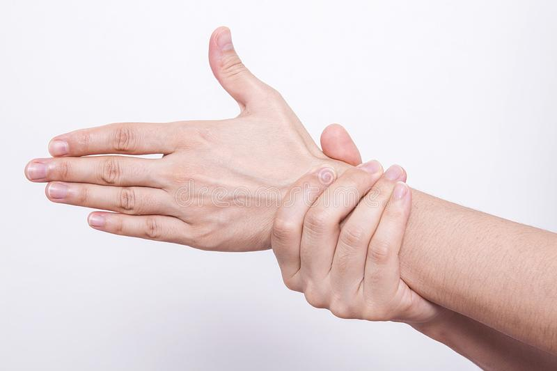 Woman holding her wrist. Pain concept. Woman holding hand to spot of wrist pain. Office Syndrome.Wrist pain stock photos