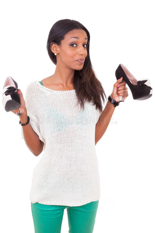 Woman holding a high heel shoe in her hands. Happy african american woman holding a high heel shoe in her hands royalty free stock images