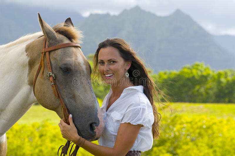 Woman holding a horse stock photography