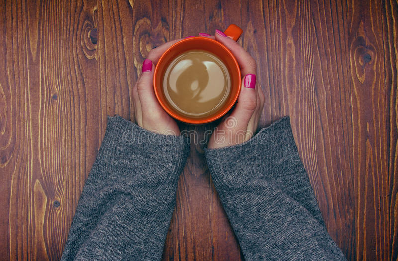 Woman holding hot cup of coffee stock image