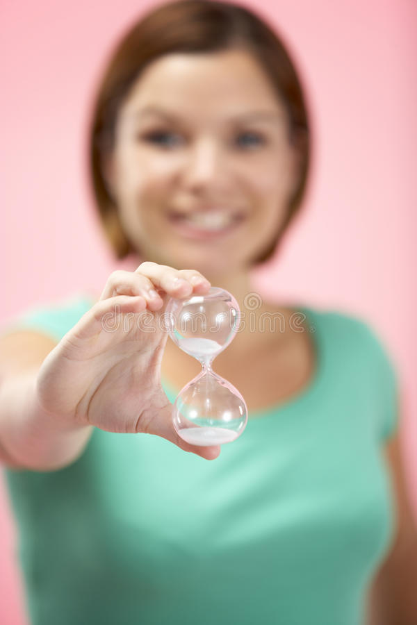 Woman Holding Hourglass royalty free stock photo