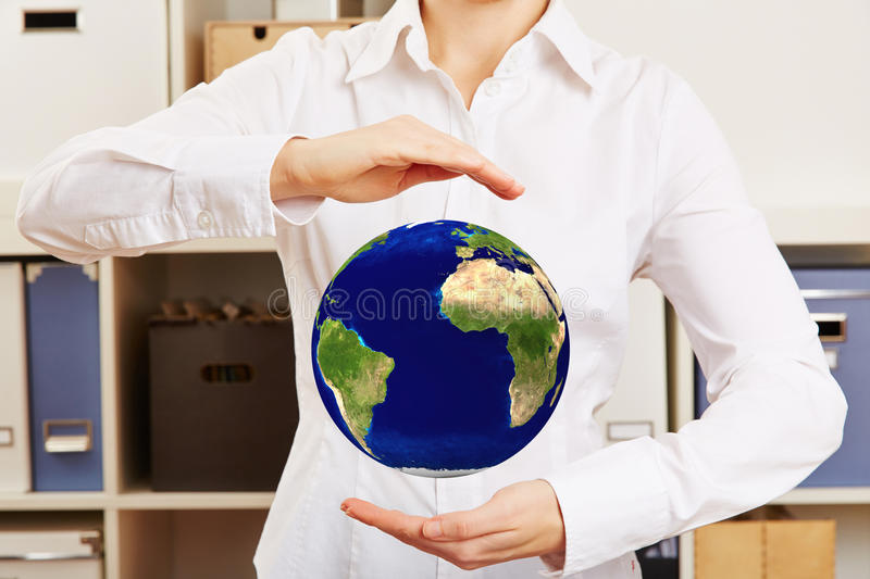 Woman holding hovering world globe. Business woman holding hovering world globe in her hands royalty free stock images
