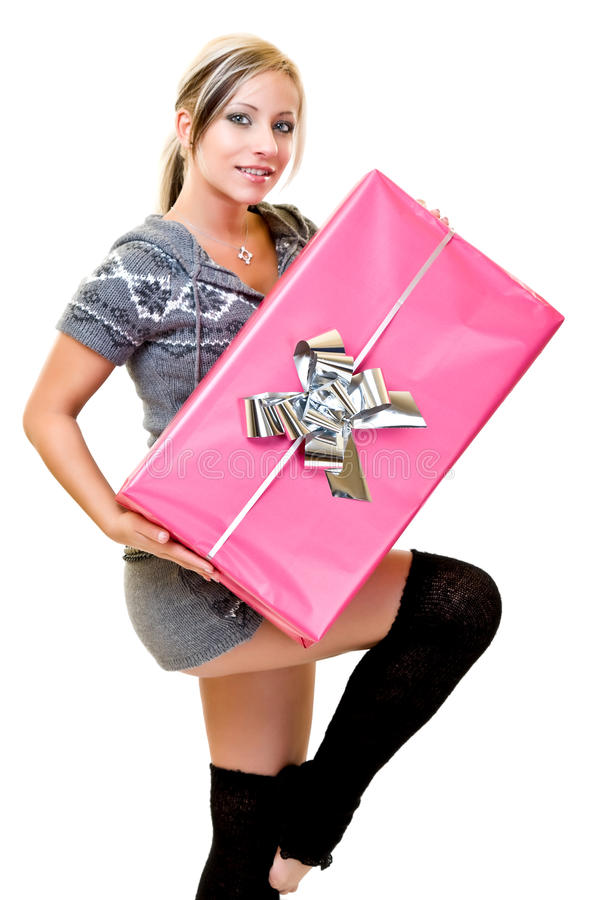 Woman holding a huge pink present