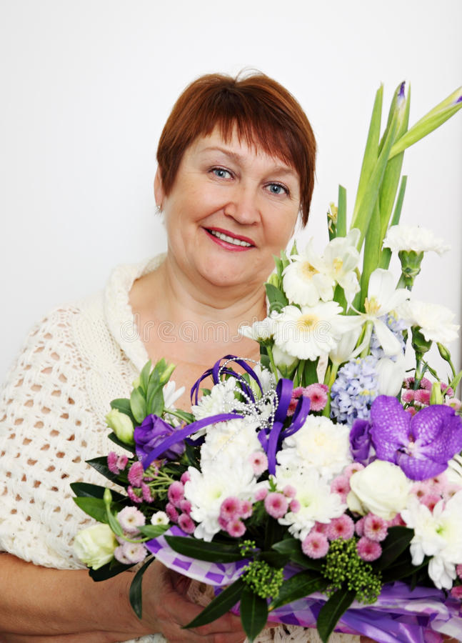Woman holding a ikebana stock images