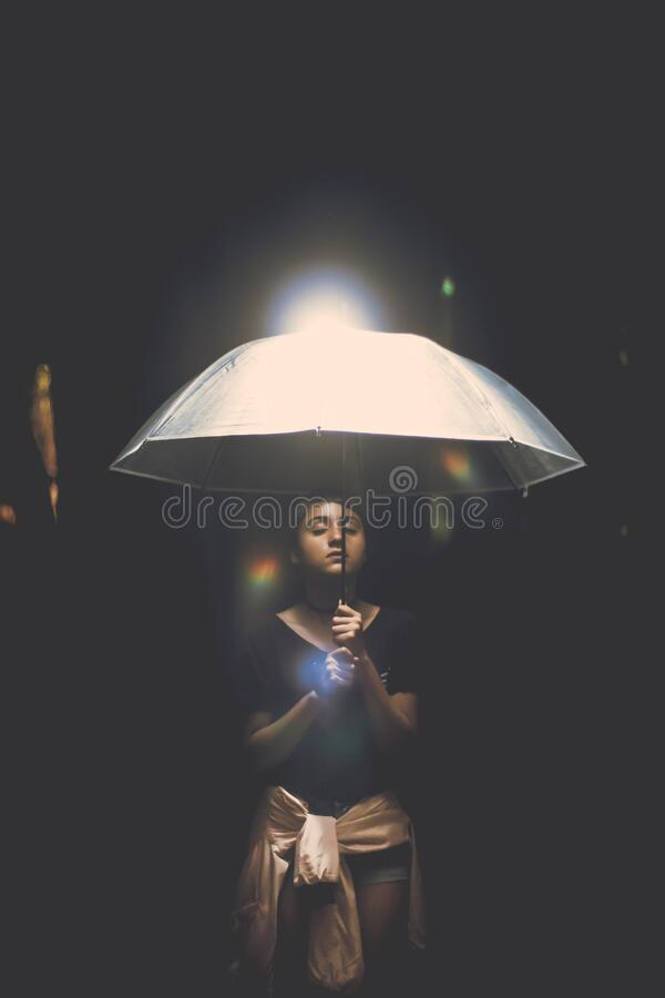 Woman Holding Illuminated Lamp at Night royalty free stock photography