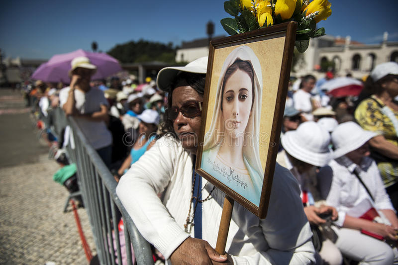 Woman holding a image at the Sanctuary of Fatima during the celebrations of the apparition of the Virgin Mary stock photo