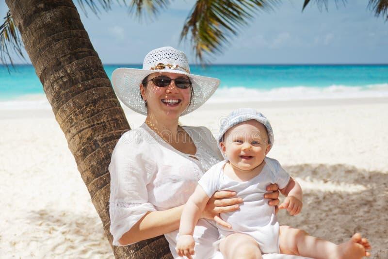 Woman Holding Infant On Beach Free Public Domain Cc0 Image