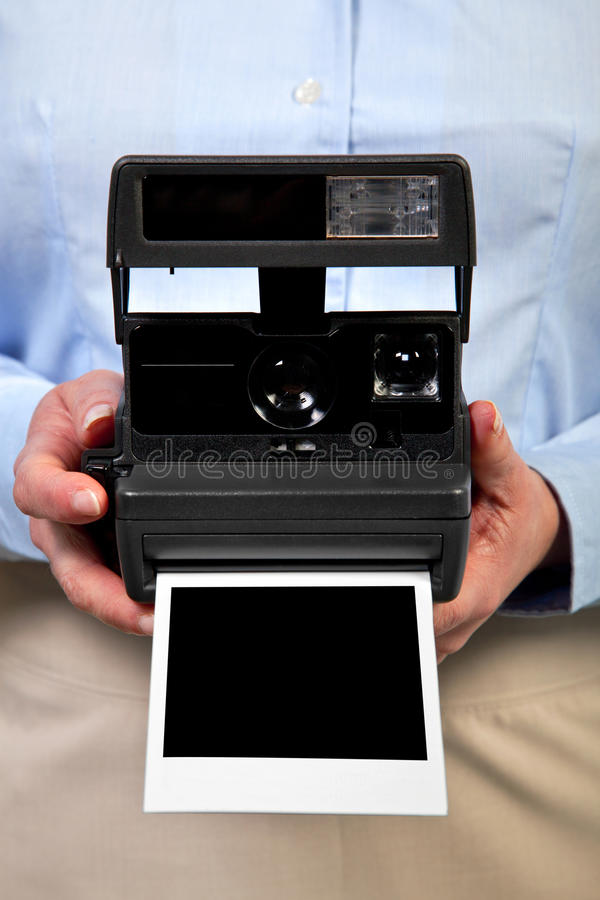 Download Woman Holding Instant Camera Blank Frame. Stock Photography - Image: 19449632