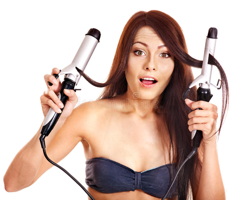 Download Woman Holding Iron Curling Hair. Stock Photo - Image: 27184242