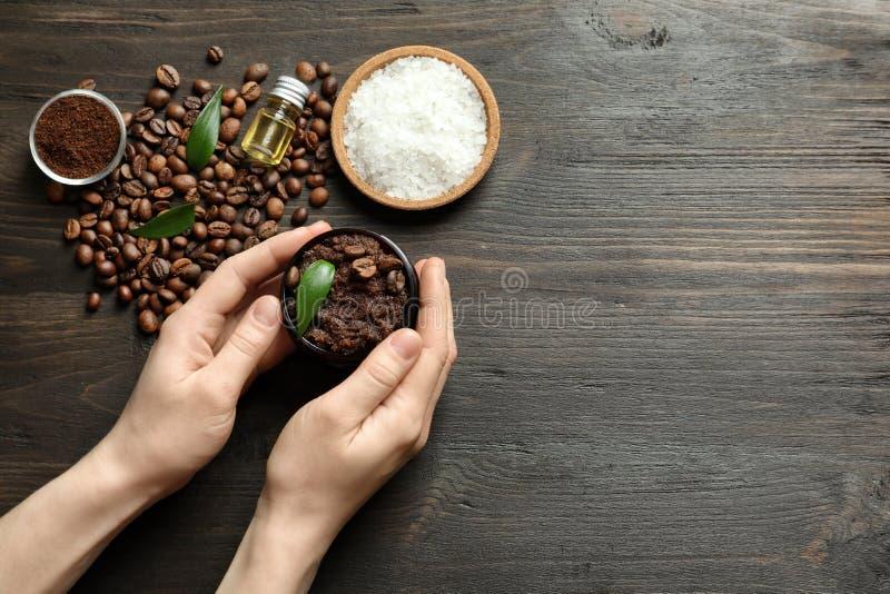 Woman holding jar of coffee scrub stock photography