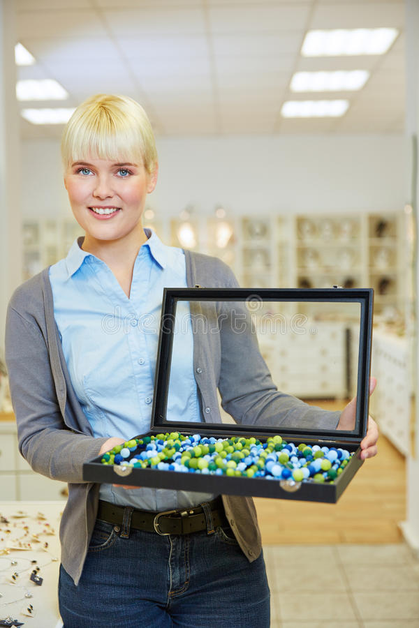 Woman holding jewelry case royalty free stock photos