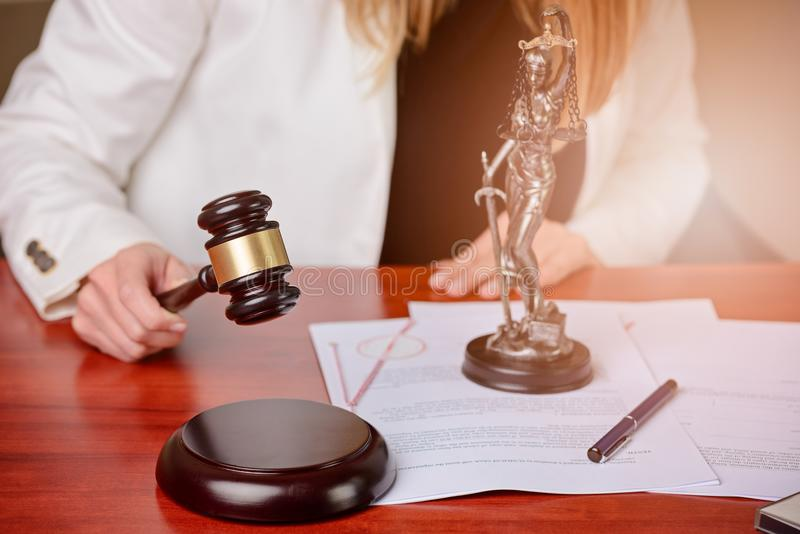Woman holding judge gavel. royalty free stock images
