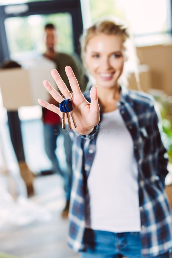 Woman holding keys stock photo