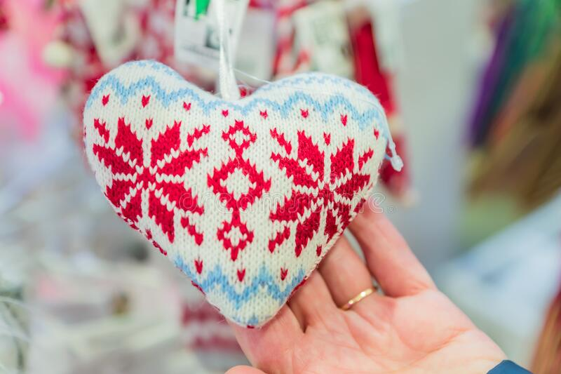 Woman holding knitted heart. Gift choice for St Valentine`s day stock images