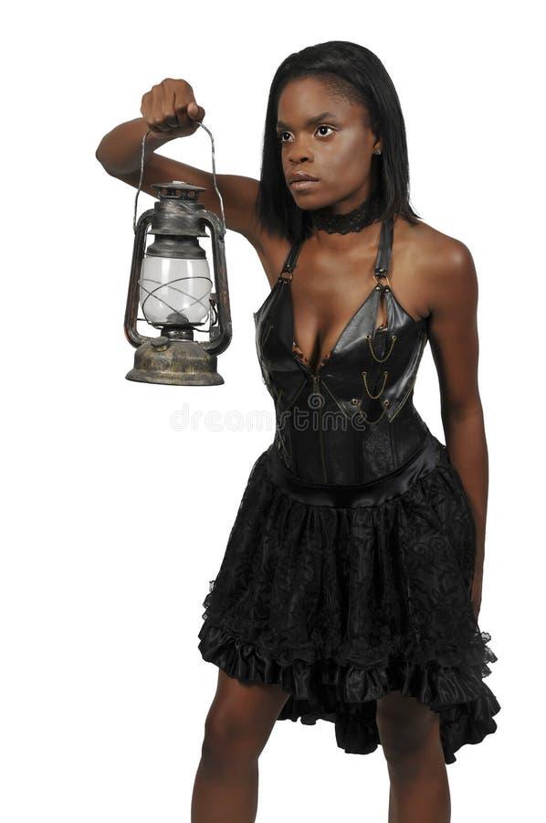 Woman holding lantern stock photography