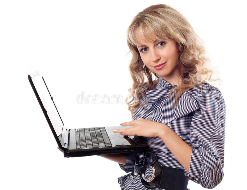 Woman holding laptop. Portrait of young beautiful woman holding laptop - isolated on white royalty free stock image